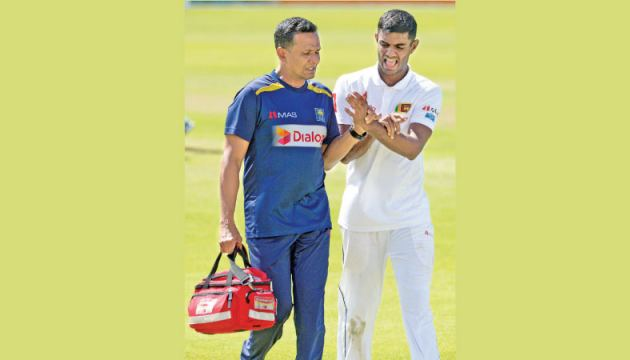 Sri Lanka spinner Lasith Embuldeniya (R) walks off the ground after injuring his finger during the first day of the second Test against South Africa at St. George's Park Stadium, Port Elizabeth on Thursday. - AFP