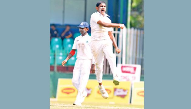 Thurstan paceman Bavantha Jayasinghe in a jubilant mood after capturing the wicket of Isipathana's top scorer Thevindu Dickwella for 40 on the first day of the 56th Battle of Brothers at the SSCs grounds Pictures by Shan Rambukwella