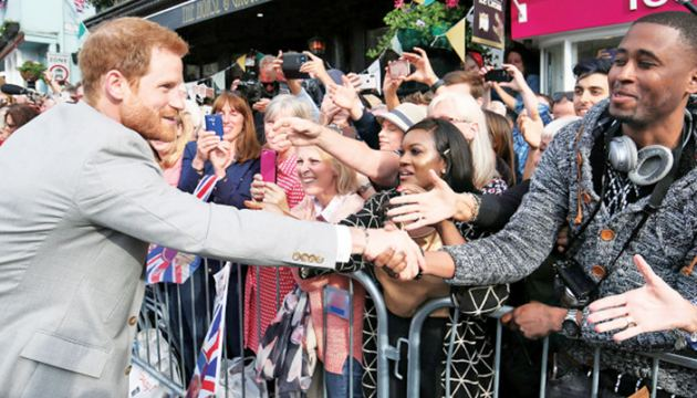 Prince Harry greeting his fans.