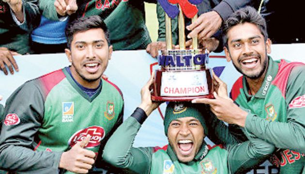 Bangladesh's Mushfiqur Rahim (C) holds the winner's trophy as Bangladesh cricketers celebrate victory after the one-day international Tri-Nation Series final against West Indies at the Malahide cricket club, in Dublin. - AFP
