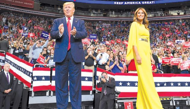 US President Donald Trump and First Lady Melania Trump arrive for the official launch of the Trump 2020 campaign at the Amway Center in Orlando, Florida on Tuesday.