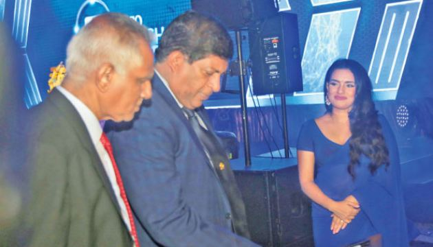 Minister Ravi Karunanayake launching the MYLECO App, looked upon by Chairman, LECO, Tissa Nanayakkara. Picture by Shan Rambukwella