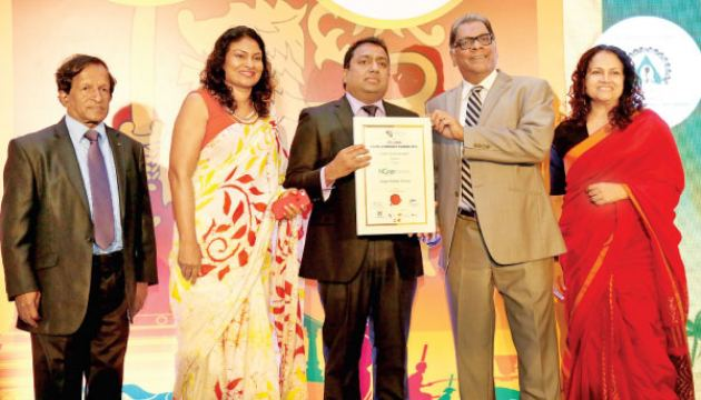 Chairman Nimal Gunewardena, CEO Sheron Jayasundara and CFO Chamika Colonne, receiving the Brand Leadership Award from Minister Akila Viraj Kariyawasam at the awards ceremony