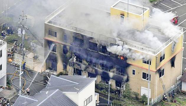 Smoke billows from a three-story building of Kyoto Animation in a fire in Kyoto, western Japan yesterday.