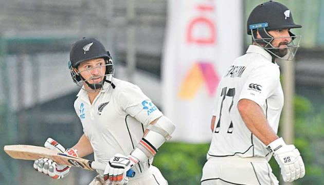 New Zealand cricketers BJ Watling (L) and Colin de Grandhomme run between the wickets during their unbroken partnership of 113 on the fourth day of the second and final cricket Test against Sri Lanka at the P. Sara Oval yesterday. – AFP