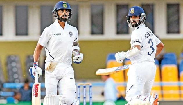 Virat Kohli (L) and Ajinkya Rahane (R) of India during their 104 run partnership during day 3 of the 1st Test against West Indies at Vivian Richards Cricket Stadium in Antigua and Barbuda on Saturday. - AFP