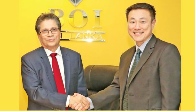Mangala Yapa, Chairman BOI and Danny Lee, Director, Sugih Energy International Pte Ltd after signing the agreement