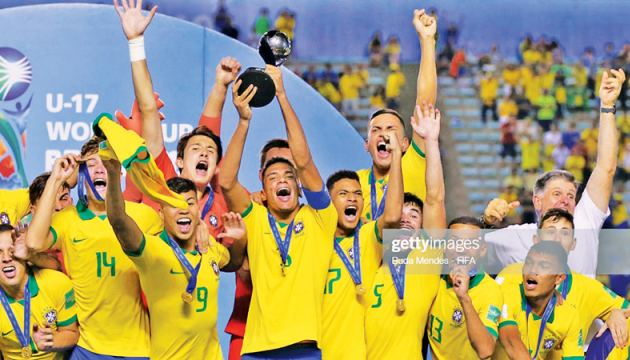 Brazil's Henri celebrates with the trophy after winning the FIFA Under 17 World Cup.