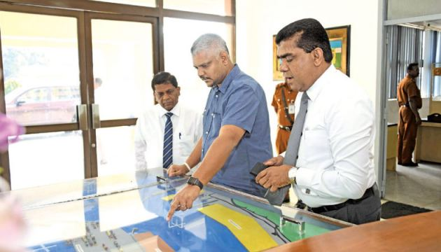 State Minister of Ports Development Kanaka Herath inspects the Jaya Container Terminal  (JCT) premises. The Additional Managing Director of Sri Lanka Ports Authority (SLPA)  Upali De Zoysa and the Secretary to the  State Minister of Ports Development N.P.V.C.Piyathilake are also in picture.