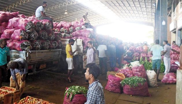 Several lorries with vegetable loads in the DDEC waiting to be unloaded..