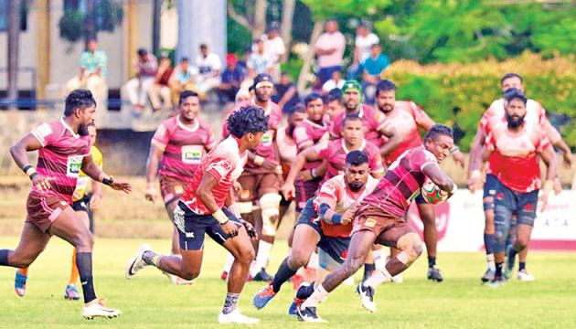 Havelocks on the offensive with CH & FC players in hot pursuit during the Dialog Club Rugby League Championship clash at Racecourse Stadium yesterday. Picture Saman Sri Wedage