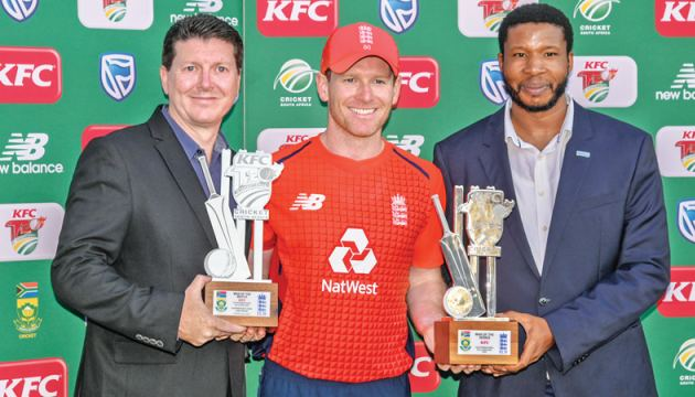 """England's Eoin Morgan (C) poses after being awarded """"Man of the Match"""" and """"Man of the Series"""" after the third T20 International cricket match against South Africa at SuperSport Stadium in Pretoria on Sunday. AFP"""