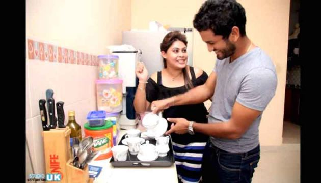 Sri Lanka cricket captain Dimuth Karunaratne tries his hand in the kitchen watched by his wife Anuradha.