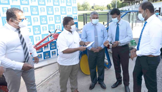Minister of Education, Youth Affairs and Sports Dullas Alahapperuma handing over of ground equipment to one of the schools.