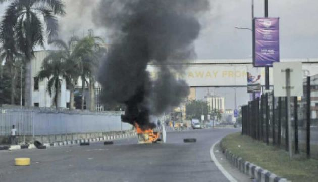 Burning barricades set by protesters against police brutality in Lagos, Nigeria on Wednesday.