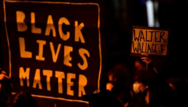 Demonstrators gather in protest near the location where Walter Wallace, Jr. was killed by two police officers in Philadelphia, Pennsylvania. (AFP)