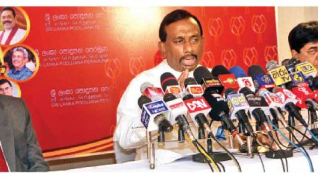 Minister of Agriculture Mahindananda Aluthgamage speaking at a Sri Lanka Podujana Peramuna media briefing held at the Water's Edge Hotel yesterday. Picture by Wimal Karunathilake