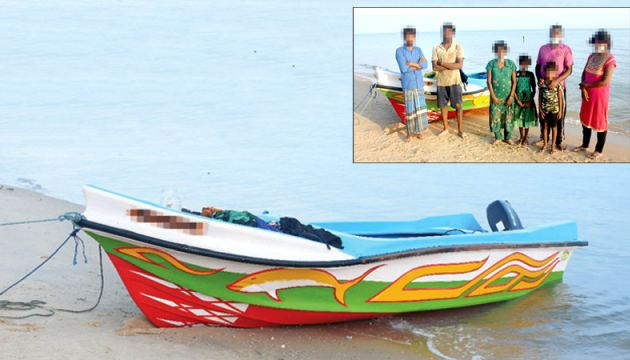 The suspects nabbed by the Navy and the seized dinghy.