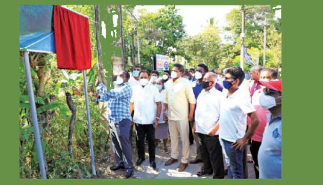 State Minister for Rural Roads and Residual Infrastructure Nimal Lanza inaugurating a road development project.