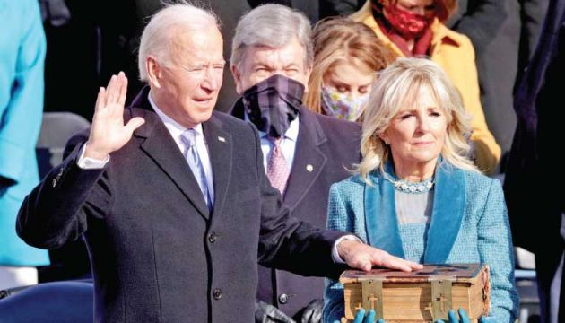 Joe Biden is sworn in as US President as his wife Jill Biden looks on during his inauguration on the West Front of the US Capitol on January 20, 2021 in Washington, DC.