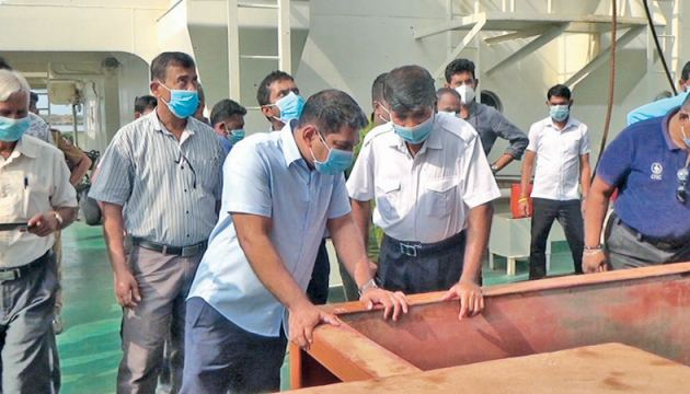Fisheries State Minister, Kanchana Wijesekera and officials inspecting a compartment.