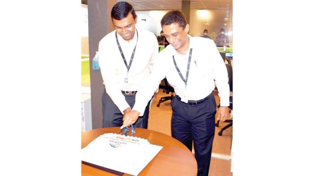 Sunshine Consumer Lanka Limited Managing Director Shyam Sathasivam and Chief Executive Officer Surith Perera celebrates the rebranding with staff members