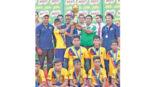 M. Habbeb, captain of the Barcelona Football Academy Under-14 Team receiving the Trophy from Rajendra Wijesiri, Activations and Sponsorship Manager Nestle Lanka PLC. Also in the picture are M. Kabeer, founder of Barcelona Football Academy and other officials.