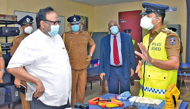 Minister of Public Security Rear Admiral (Retd.) Dr. Sarath Weerasekera talks to one of the personnel during his inspection tour of the Police Training College, Kalutara on Monday.
