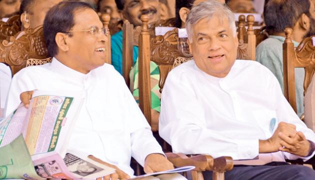 President Maithripala Sirisena and Prime Minister Ranil Wickremesinghe share a light moment