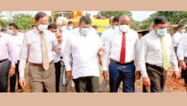 State Minister Dr. Nalaka Godahewa  and Ministry Secretary Sirinimal Perera at the inauguration of construction of the housing project for middle income families