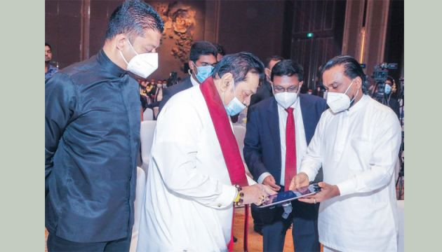 Prime Minister Mahinda Rajapaksa launches the Standard Operating Procedures on Vehicle Manufacturing, Vehicle Assembling and Manufacture of Vehicle Accessories in Sri Lanka with Minister of Industries, Wimal Weerawansa and other Ministers at the event. Picture by Dushmantha Mayadunna