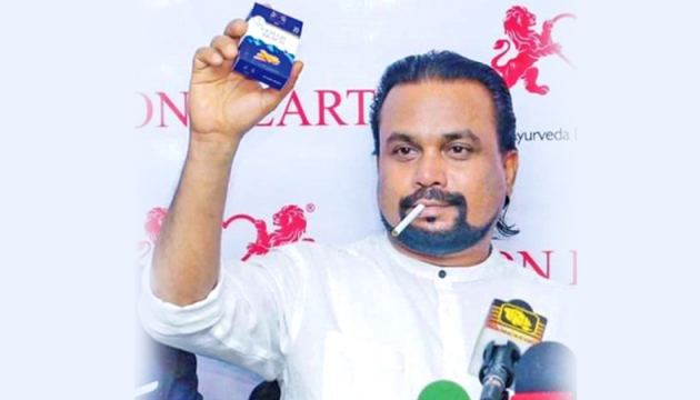 Minister Weerawansa with the newest Ayurvedic smoking invention.