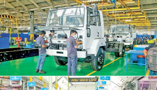 Industry Minister Wimal Weerawansa, Director Lanka Ashok Leyland, Umesh Gautam and other officials at the Lanka Ashok Leyland Auto Assembly plant in Jalthara, Homagama