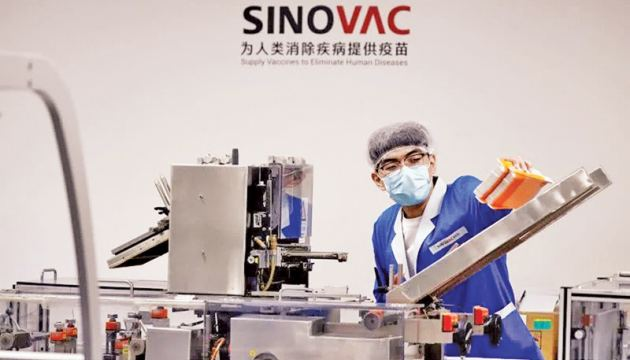 Work at a factory of Chinese vaccine maker Sinovac Biotech in Beijing.