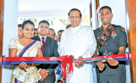 President Maithripala Sirisena opens the house of artillery gunner of the Sri Lanka army Sampath Sri Palansuriya who was adjudged the winner of the 5th Mission of the Ranavi Real Star Reality Show held at Prabuddagama Ranaviru village, Horana yesterday. The President also presented the ownership of houses to 34 contestants who were selected to the final round of the competition on this occasion. Picture by Sudath Silva