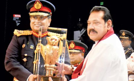 memento for PM: Prime Minister Mahinda Rajapaksa who was the Chief Guest at the Defence Services Command and Staff College graduation ceremony held at the Nelum Pokuna Theatre receives a memento from the Commandant  of the college Major General Prabath Dematanpitiya. Picture by Gayan Pushpika