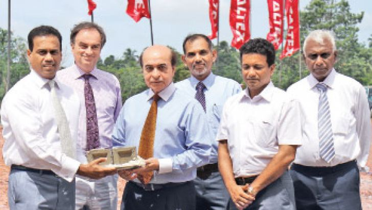 Chairman of CLLP, Farrukh Saeed, and Kishu Gomes, Managing Director/CEO of CLLP holding the foundation stone at the official ceremony. Also present were Richard Brown, Board Director - CLLP, Anura Perera, Director Finance-CLLP and Wijitha Akmeemana,General Manager- Supply Chain of CLLP and Joe Senadhipathi, Managing Director of Indo East Engineering and Construction (Lanka) Pte Ltd.