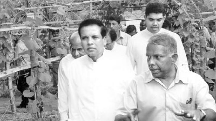 SLFP General Secretary and Health Minister Maithripala Sirisena viewing the agricultural exhibition at Wariyapola. Agriculture Minister Mahinda Yapa Abeywardena and MPs are also in the picture.