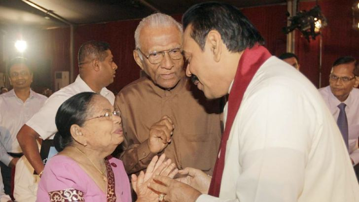 "A commemorative ceremony to mark the second death anniversary of well known literary personality Arisen Ahubudu titled "" Athu Aga Dili Mal Arisen Ahubudu Gee Saraniya"" organized by the Arisen Ahubudu Foundation was held at the BMICH Colombo under the patronage of President Mahinda Rajapaksa. Here, a copy of the Arisen Ahubudu Gee Saraniya Souvenir ""Sakvithi Kith Res"" being presented to President Rajapaksa by Mrs. Arisen Ahubudu during the event. External Affairs Minister Prof. G. L. Peiris, Cooperatives and"
