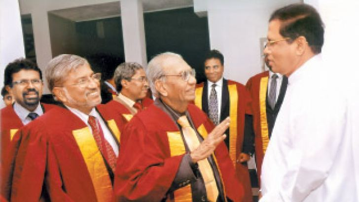 Health Minister Maithripala Sirisena with JMOs during the ceremony.