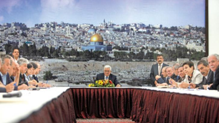 Palestinian President Mahmud Abbas smiles during a meeting with the Palestinian central committee in the West Bank city of Ramallah on July 18 to discuss the peace plan proposed by US Secretary of Sate John Kerry. AFP