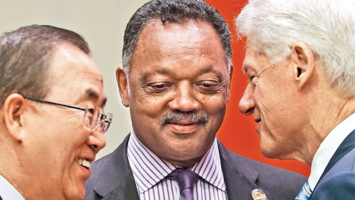 Former U.S. President Bill Clinton (R), United Nations Secretary-General Ban Ki-moon and Rev. Jesse Jackson speak before the start of an informal meeting of the plenary of the General Assembly, on the commemoration of the Nelson Mandela International Day, at UN headquarters on July 18 in New York City. AFP
