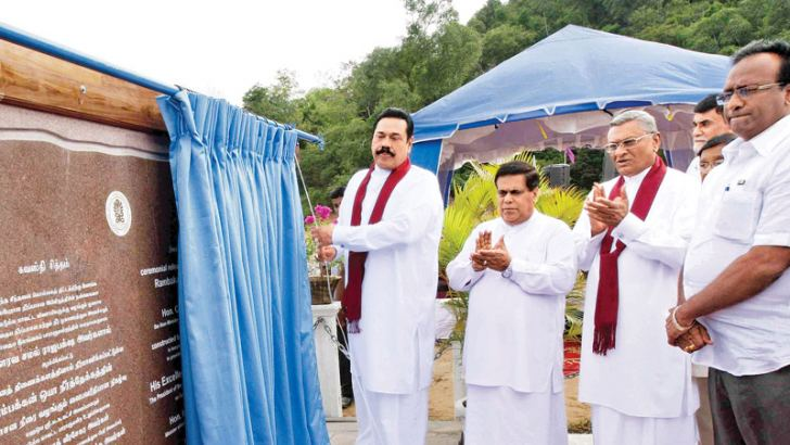 President Mahinda Rajapaksa commissioning the Rambaken Oya reservoir project in the Maha Oya Divisional Secretariat area in the Ampara district on Saturday. Looking on are Speaker Chamal Rajapaksa and Minister Nimal Siripala de Silva.