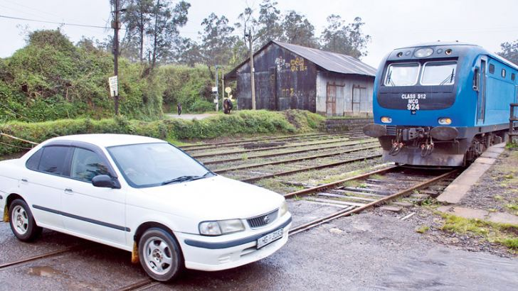 The spate of rail tragedies at level crossings in recent times appears not to have made this motorist any wiser as he dashes through this level crossing in Ambewela, impervious to the lurking danger. Picture by Nissanka Wijeratne