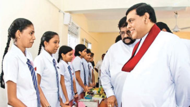 Economic Development Minister Basil Rajapaksa  in conversation with students of  Yasodhara Devi Balika Vidyalaya, Gampaha -- after opening the Yasabhimani 2013 Educational Exhibition.