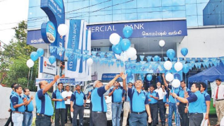 Commercial Bank's senior management and staff join in the release of balloons at the finale of the Savings Fiesta