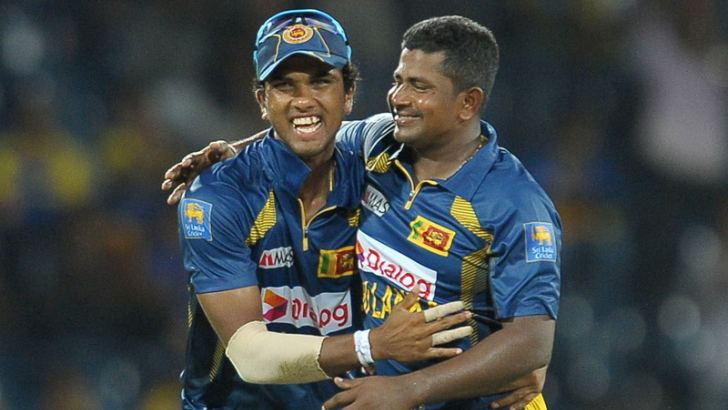 Dinesh Chandimal, who had a memorable first outing as Captain of Sri Lanka, celebrating with Rangana Herath as he bowled for Sri Lanka to a convincing victory over South Africa in the first one day game at R.Premadasa Stadium on Saturday. AFP