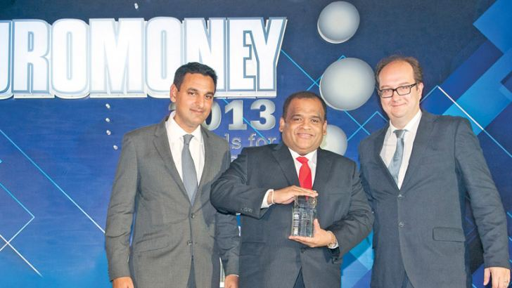 Sampath Bank won the prestigious Euromoney magazine's Best Bank of Sri Lanka 2013 Award. Here Dhammika Perera, Chairman Sampath Bank PLC (Center) holding the award flanked by Clive Horwood, Editor of Euromoney and Anuj Gangahar, Asia Editor of Euormoney at the award ceremony held at Hotel Conrad, Hong Kong.