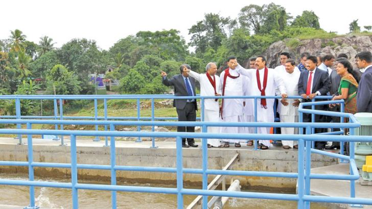 President Mahinda Rajapaksa is seen inspecting the Biyagama Water Treatment Plant after its opening yesterday. Ministers Dinesh Gunewaredene and Basil Rajapaksa were also present. Picture by Nalin Hewapathirana