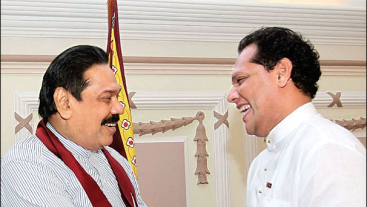 Kurunegala District UNP MP Dayasiri Jayasekera who tendered his resignation from Parliament yesterday evening, called on President Mahinda Rajapaksa at Temple Trees. At this meeting he received SLFP membership from the President and pledged his support for the UPFA victory at the forthcoming Wayamba Provincial Council Election. He is expected to contest the Wayamba Provincial Council Election as the UPFA Chief Ministerial candidate. Picture by Udesh Gunaratna